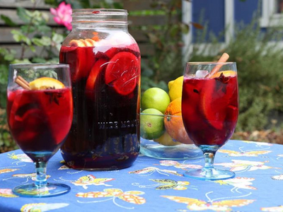 """<a href=""""https://everout.com/stranger-seattle/locations/cafe-nordo/l15512/"""">Cafe Nordo</a>'s spicy, floral ros&eacute; sangria is perfect for the last sun-drenched days of summer."""
