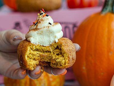 """Embrace the season with <a href=""""https://everout.com/portland-mercury/locations/voodoo-doughnut/l25254/"""">Voodoo Doughnut</a>'s """"Dashing Pumpkin Doughnut,"""" a pumpkin cake doughnut with cream cheese frosting, sprinkles, and pumpkin spice."""