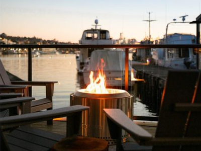 """Perch on one of the Adirondack chairs at Renee Erickson's waterfront restaurant <a href=""""https://everout.com/stranger-seattle/locations/westward/l16533/"""">Westward</a> beside a roaring fire and admire the view of Lake Union."""