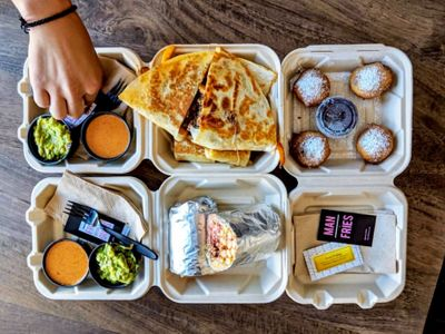 """The new takeout and delivery pop-up <a href=""""https://everout.com/stranger-seattle/locations/man-vs-fries/l39686/"""">Man Vs. Fries</a> brings fry-and-Cheeto-stuffed burritos and Krusteaz-battered Oreos to Seattle this Tuesday."""