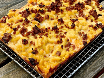 """Believe it or not, this Detroit-style bacon mac and cheese pizza from <a href=""""https://everout.com/portland-mercury/locations/boxcar-pizza/l39786/"""">Boxcar Pizza</a> is 100% vegan."""