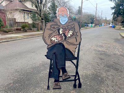 """The internet is flooded with memes of Bernie Sanders <span style=""""text-decoration: line-through;"""">waiting in line at the DMV</span> at Biden's inauguration, but Portland artist Mike Bennett's handpainted <a href=""""https://everout.com/portland-mercury/events/mike-bennetts-bernie-sanders-meme/e40733/"""">cardboard cut-out version</a> definitely takes the cake. Go see it in the Alberta Arts District while you can."""