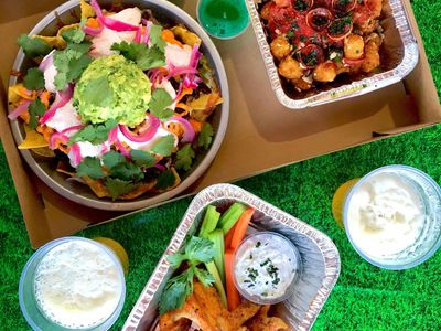 """<a href=""""https://everout.com/stranger-seattle/locations/serious-takeout/l13557/"""">Serious TakeOut</a>'s """"big game ultimate snack pack"""" features buffalo wings, blue cheese, celery and carrot sticks, <a href=""""https://everout.com/stranger-seattle/locations/cantina-lena/l16097/"""">Cantina Lena</a>'s famous nachos, """"pizza tots,"""" and two themed Jell-O shots for your team of choice."""