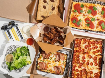 """<a href=""""https://everout.com/portland-mercury/locations/pop-pizza/l39787/"""">Pop Pizza</a>'s deluxe Super Bowl combos include Detroit-style pizza, salads, cookie squares, and optional wings from <a href=""""https://everout.com/portland-mercury/locations/hat-yai/l20533/"""">Hat Yai</a>&nbsp;and beer from <a href=""""https://everout.portlandmercury.com/locations/away-days-brewing-co/l19299/"""">Away Days Brewing Co</a>."""