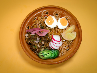 """Try specialties like birria ramen at the newly opened food cart <a href=""""https://everout.com/portland/locations/birrieria-pepe-chile/l40354/"""">Birrieria Pepe Chile</a>."""
