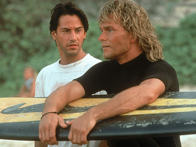 """Just a couple of surfer bros in one of the best action movies of the past few decades, <i><a href=""""https://everout.thestranger.com/movies/point-break/A15566"""">Point Break</a></i>."""