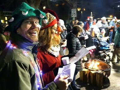 """The Phinney Neighborhood Community Chorus will lead you in <a href=""""https://www.thestranger.com/events/42303736/caroling-under-garys-canopy"""">holiday carols</a> underneath Gary's Greenwood Auto Repair's rainproof canopy on December 21."""