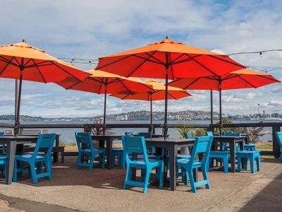 """<a href=""""https://everout.com/seattle/locations/marination-ma-kai/l16659/"""">Marination Ma Kai</a>'s patio is worth the trip to West Seattle."""