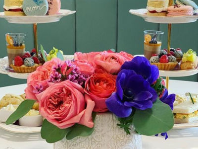 """Make your mom's teatime dreams come true with <a href=""""https://everout.com/seattle/locations/fogrose/l14610/"""">Fogrose Ice Cream</a>'s high tea set, which comes with fresh flowers."""