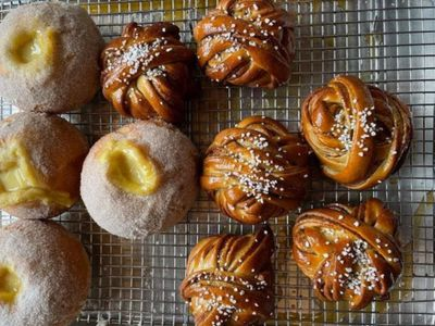 """The new bakery <a href=""""https://everout.com/seattle/locations/saint-bread/l40705/"""">Saint Bread</a>, currently open Tuesday-Friday, is bringing vanilla custard rolls and kanelbullar (Scandinavian cinnamon knots) to Portage Bay."""