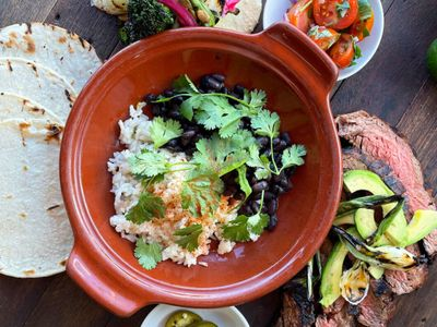 """<a href=""""https://everout.com/seattle/locations/serious-takeout/l13557/"""">Serious TakeOut</a>'s Cinco de Mayo dinner box comes with tequila-marinated carne asada and all the fixings for tacos."""