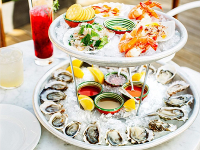 """Indulge your extravagant side with an ice-cold seafood tower from <a href=""""https://everout.com/seattle/locations/westward/l16533/"""">Westward</a>."""