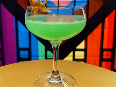 """<a href=""""https://everout.com/portland/locations/abigail-hall/l19616/"""">Abigail Hall</a>'s glittery green """"Party Favor"""" cocktail pays homage to Billie Eilish."""