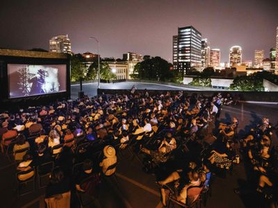 """The Northwest Film Center's two-pronged <a href=""""https://everout.com/portland/events/cinema-unbound-summer-movie-series/e101517/"""">Cinema Unbound</a> series brings open-air screenings of <em>Wonder Woman</em> and <em>Nomadland</em> to Lloyd Center's rooftop this weekend."""
