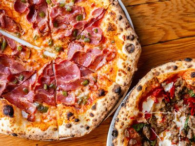 """Baker Ken Forkish's pizzeria <a href=""""https://everout.com/portland/locations/kens-artisan-pizza/l24838/"""">Ken's Artisan Pizza</a> has received national attention for its wood-fired pies."""