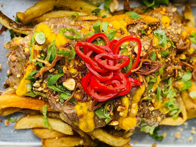 """The cart <a href=""""https://everout.com/portland/locations/baon-kainan/l40641/"""">Baon Kainan</a>, opening this weekend, mixes traditional Filipino cooking with influences from American fast food, resulting in dishes like kare-kare fries."""