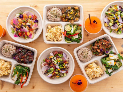 """Grab Hawaiian plate lunches, poke bowls, and P.O.G. slushies at <a href=""""https://everout.com/portland/locations/sugarpine-drive-in/l39944/"""">Sugarpine Drive-In</a>'s food truck pop-up <a href=""""https://everout.com/portland/locations/da-pine/l40671/"""">Da Pine Grinds</a>."""