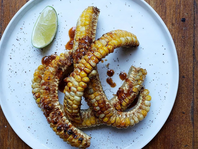 """<a href=""""https://everout.com/portland/locations/lang-baan/l20800/"""">Langbaan</a> puts its own spin on the corn ribs trend with chili jam, Sichuan peppercorns, and northern Thai spices."""