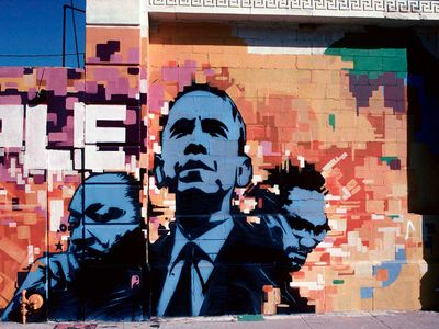 "This photograph of a Los Angeles mural (featuring Martin Luther King, Jr., Barack Obama, and Malcom X) is part of the Smithsonian's touring <a href=""https://www.thestranger.com/events/42009770/men-of-change-power-triumph-truth"">Men of Change</a> exhibit, currently on view at the Washington State History Museum."